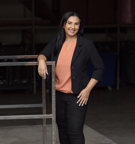 DLO office moving experts - DLO team member Sherina Khan in front of metal bar